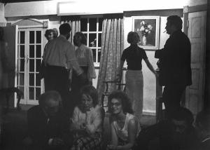 """A unique photo this; during a pause in rehearsal Fred (seated left), Mary Timlin (centre) and Val discuss some obstruse point. Notice that the main theatre lights are out and the area is only lit by the low-wattage """"working light"""" which throws people on-stage into silhouette. Compare this scene with all the others, which are 'properly' lit."""