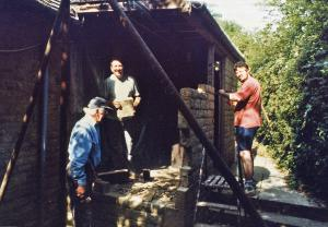L-r: Fred, Peter Wroe and Ian Bushrod trusting that rusty scaffold would keep the roof up! It did . . .