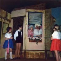 The Ugly Sisters (Daisy, played by Andrew Jenner and Buttercup, Chris Richards) are cornered by three unidentified little dancers.