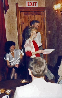 Photo from the after-show party.L-r : Jackie Finlay looks on as Val Temlett ackowledges the gift. Jim's in the background.