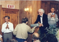 Here, l-r, are Jim Harper, Peter Burley (presenting Fred with a cast gift) and, far right, Alan Copelin.